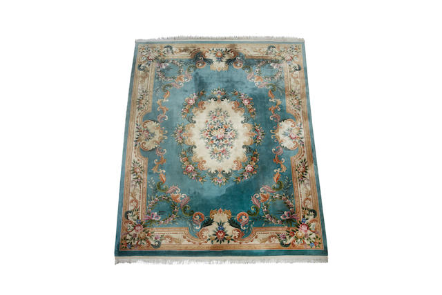 A Chinese superwash carpet with an Aubusson design 470cm x 360cm