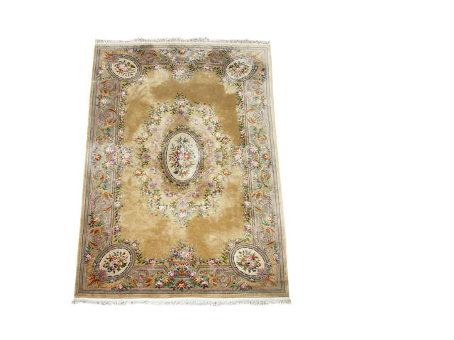 A Chinese superwash carpet with a Aubusson design 550cm x 365cm