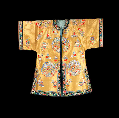 An embroidered gold-ground 'precious objects' lady's robe Qing dynasty