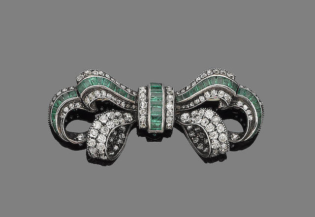 An emerald and diamond bow brooch,