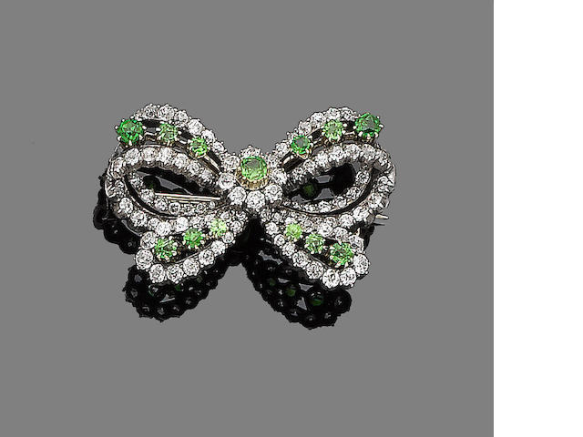 A demantoid garnet and diamond bow brooch