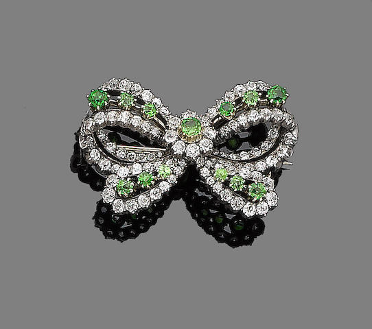 A demantoid garnet and diamond bow brooch