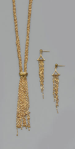A yellow precious metal necklace and earrings suite and a bangle