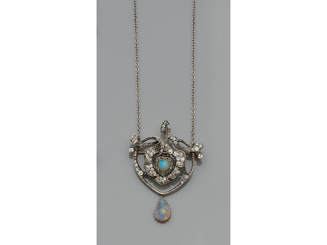 An opal and diamond brooch/pendant