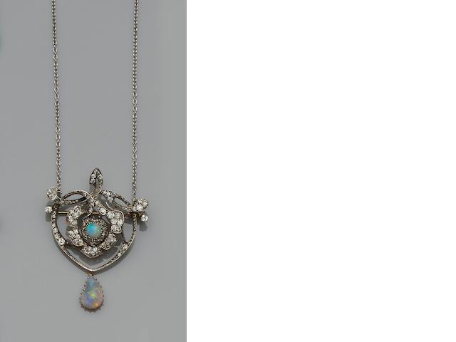 An opal and diamond brooch/pendant