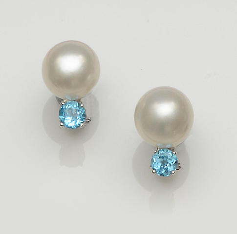 A pair of cultured pearl and topaz earstuds