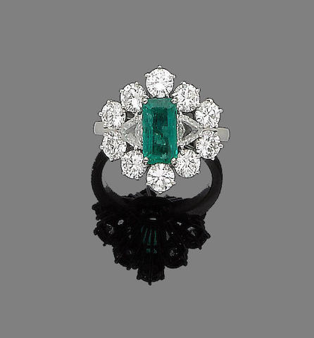 An emerald and cluster diamond ring