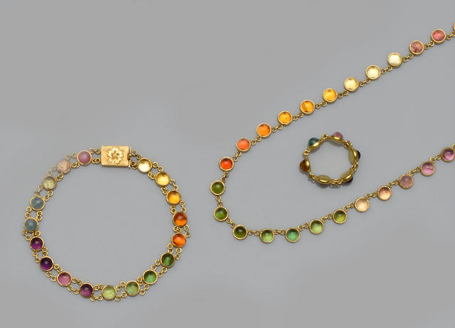A vari gem-set necklace, bracelet and ring suite (3)