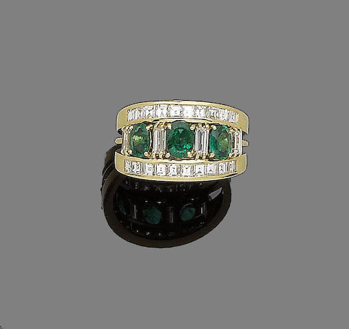 An emerald and diamond band ring