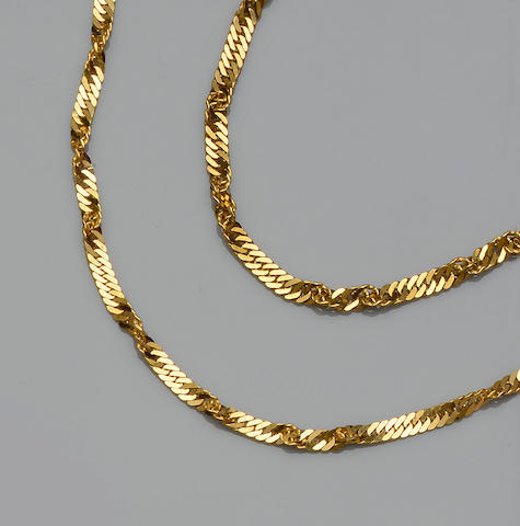 A yellow precious metal necklace and bracelet suite (2)