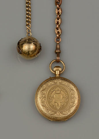 A hunter fob watch, a fancy-link Albert chain and a pendant