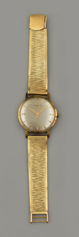 Longines: A gentleman's 9ct gold wristwatch on yellow precious metal strap