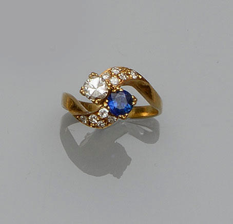 A diamond and sapphire crossover ring