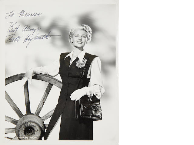 Film star signatues: A collection of signed vintage photographs in an album,