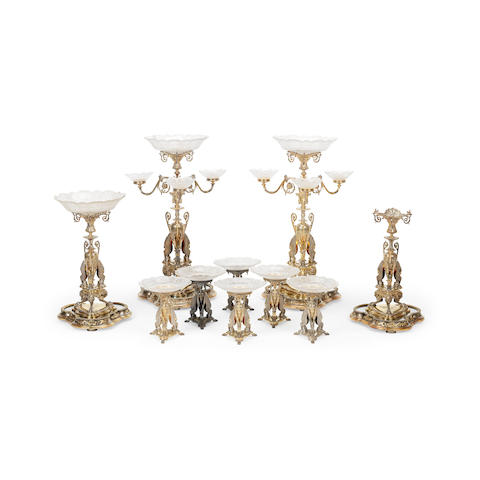 A Victorian silver and silver-gilt ten piece presentation dessert table garniture by Elkington & Co., Birmingham 1865