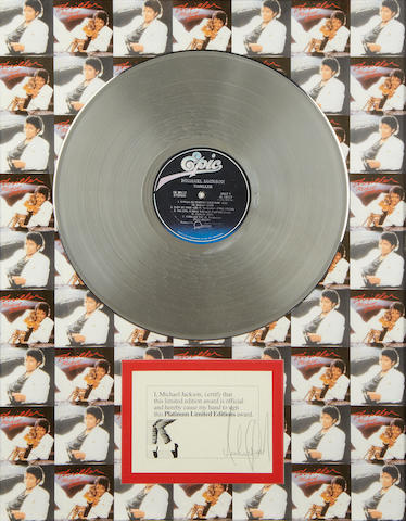Michael Jackson: An autographed limited edition 'Platinum' award for the album 'Thriller' and tour poster,