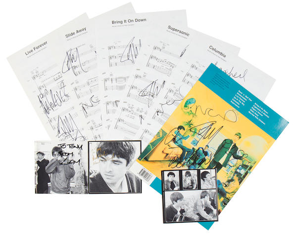 Oasis: A collection of autographed song sheets and other autograph items,