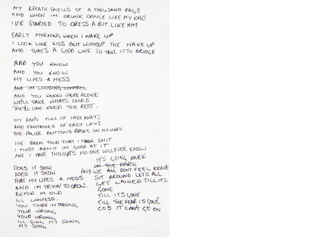 Robbie Williams: A page of handwritten lyrics for the song 'Strong',   1999 Chrysalis,