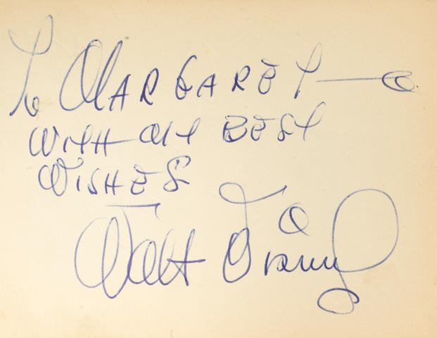 Walt Disney: An autograph book containing an inscription and signature,
