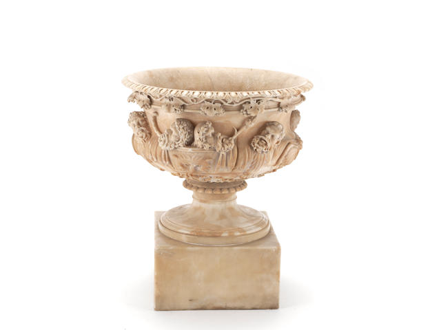 A late 19th / early 20th century carved alabaster pedestal urn on stand, modelled after the Warwick vase, probably Italian