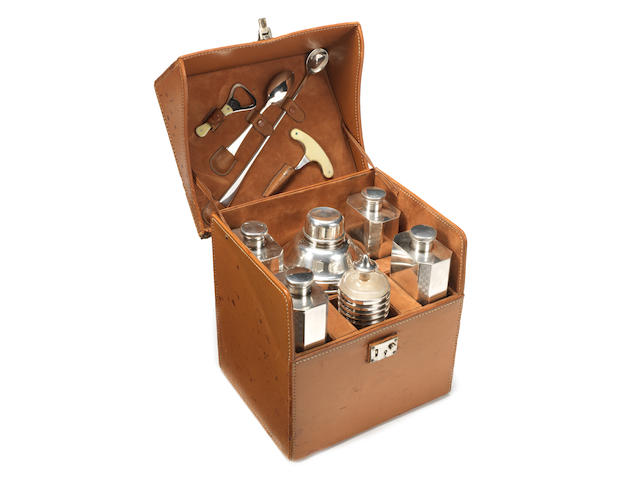 A fine specially commissioned cased cocktail set for six persons, by James Dixon & Sons, circa 1909,
