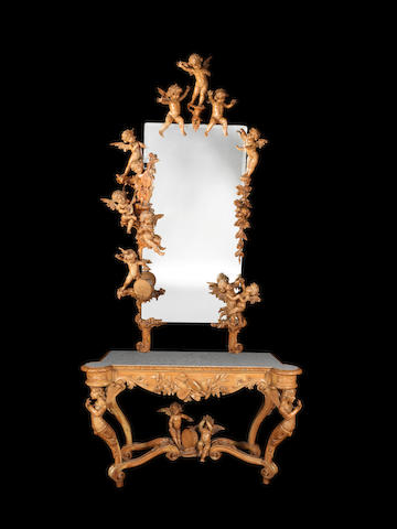 An impressive Italian late 19th century Exhibition type carved limewood console table and mirror