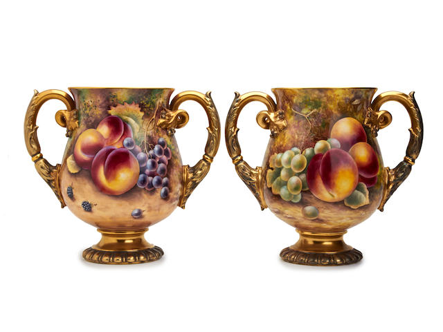 A pair of Royal Worcester fruit-painted twin handled vases, painted by James Skerrett and Terry Nutt Circa 1960-1970