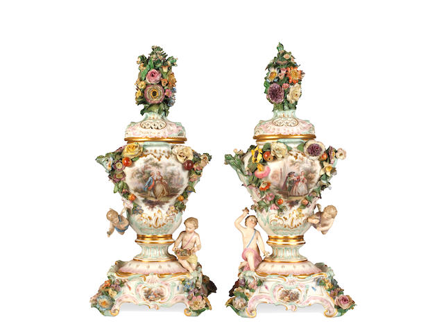 A pair of Meissen vases, covers and stands, mid to late 19th century