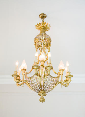 A late 19th / early 20th century French gilt bronze and gilt glass twelve light plaffonier electrolier in the Louis XVI taste
