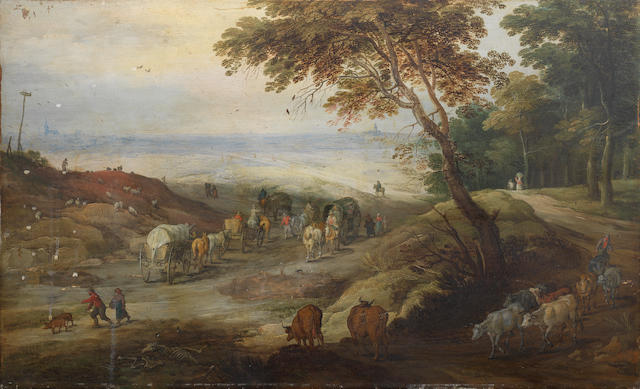 Jan Brueghel the Younger (Antwerp 1601-1678) and Joos de Momper (Antwerp 1564-1635) A country path with several wagons and other travellers on foot, a cowherd and his livestock leaving a woodland track in the foreground and an extensive landscape with two distant towns beyond