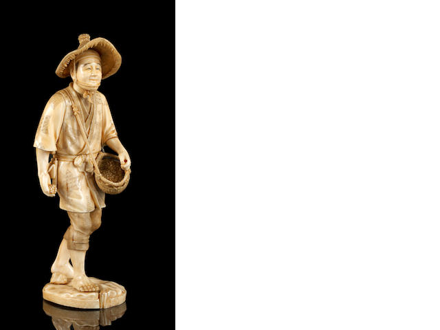 A Japanese carved ivory large okimono of a peasant, Meiji period