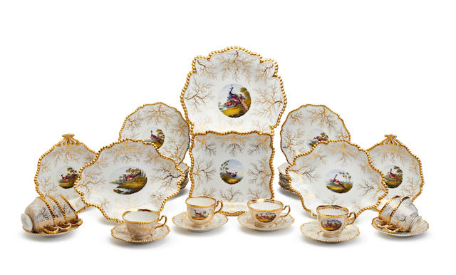 A Flight Barr and Barr part dessert service and a group of teawares, painted in the style of George Davis, early 19th century