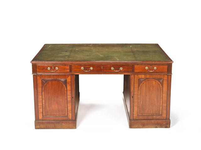 A William IV mahogany partners' pedestal desk