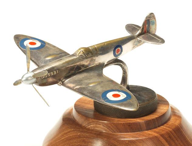 A 'Spitfire' aeroplane deskpiece mounted as a mascot,