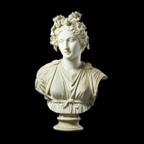 A carved white marble bust of a classical maiden with Apollo's Knot
