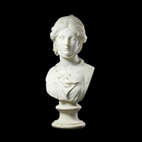 A carved white marble bust of a classical maiden with diadem
