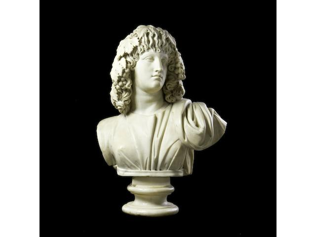 A carved white marble bust of a Baccante