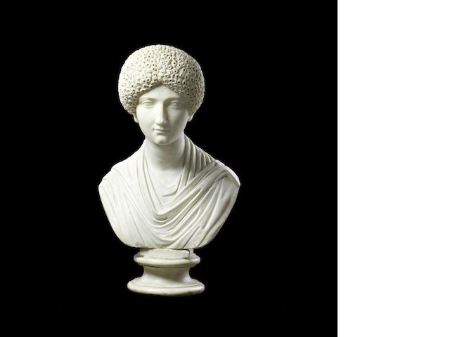 A carved white bust of an empress