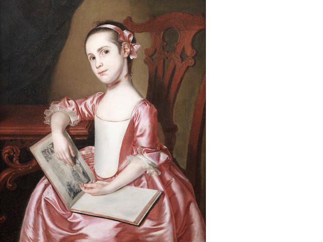 English School, 18th Century Portrait of a girl, three-quarter-length, in a pink dress and matching ribbon, seated at a table reading a book