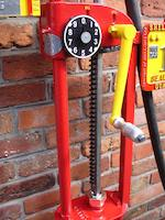 A one-gallon Bowser hand operated petrol pump,