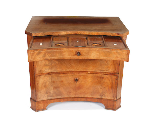 An early 19th Century Continental mahogany concave dressing chest,
