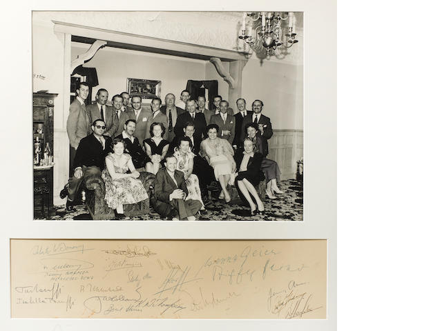 A framed photograph with autographs of the 1955 Mercedes Grand Prix team and guests,