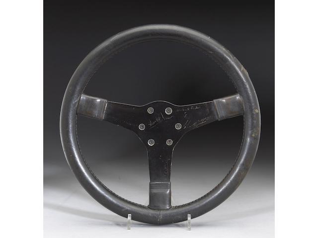 "A Porsche 917 steering wheel from the film ""LeMans"","