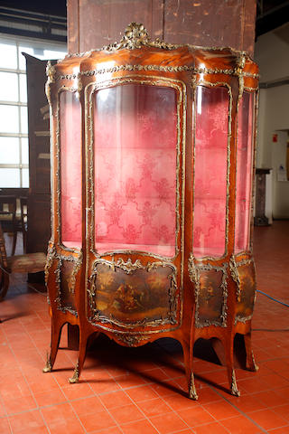An unusual late 19th century French, Louis XV style, walnut veneered and  gilt metal mounted vitrine with 5 glass panels