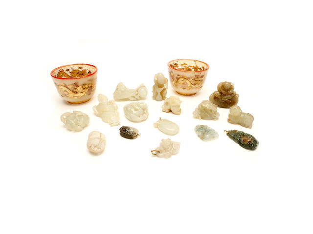 A pair of jadeite or hardstone cups and a group of jade and other hardstone items