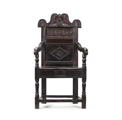 A Charles II style oak open armchair In the Yorkshire manner