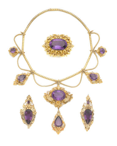 An early 19th century amethyst necklace, buckle and a pair of brooches (4) (illustrated inside the front cover)