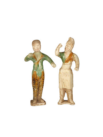 Two Chinese glazed pottery figures of grooms, Tang Dynasty