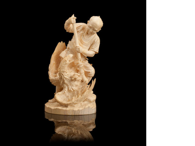 An ivory okimono of a man and eagle Meiji
