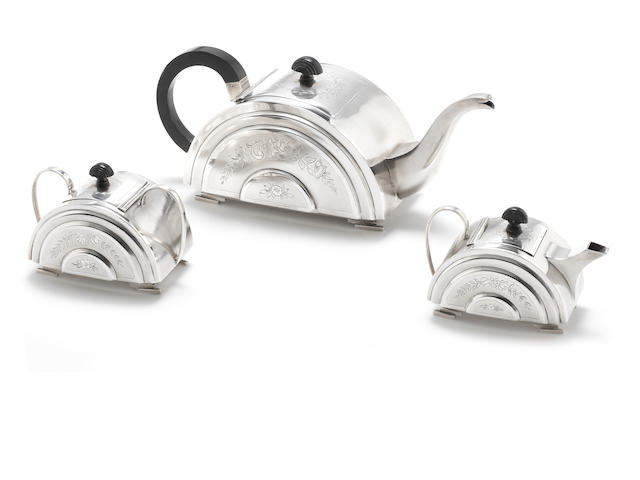 An Indian three-piece silver tea service (Teapot, Milk & Sugar)  (3)